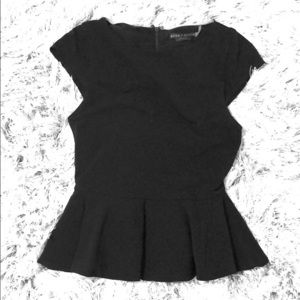 Black peplum shirt by Alice and Olivia size small